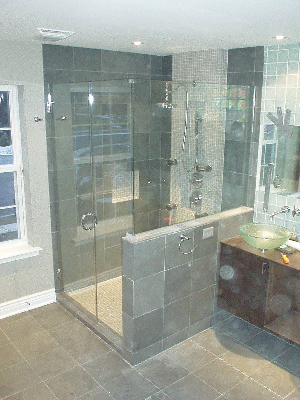 Frameless shower doors & bath enclosures